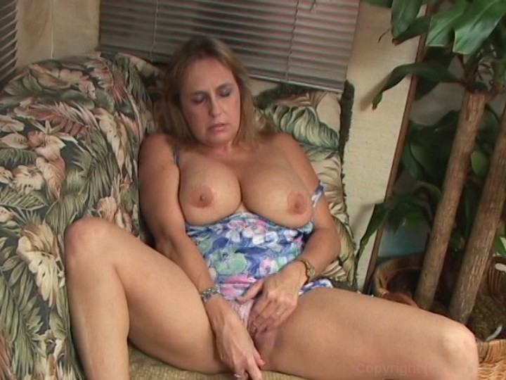 Milf plays with her pussy