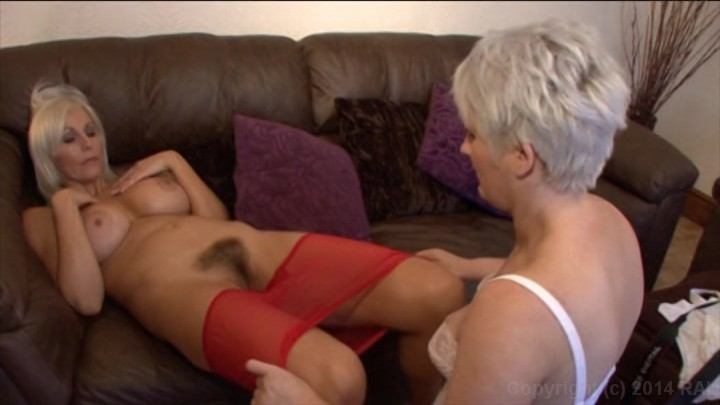 Lesbians fuck on couch