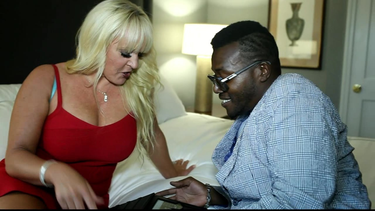 Mature blonde with black cock