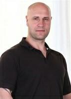 Fabrice Triple X Headshot